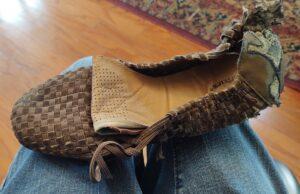 A torn-up shoe.