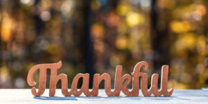 """Carved sign that reads """"Thankful."""""""
