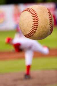 Baseball pitcher throwing a pitch.