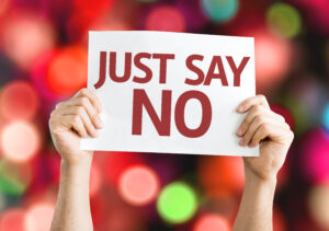 """Person holding a sign that reads """"Just say no."""""""
